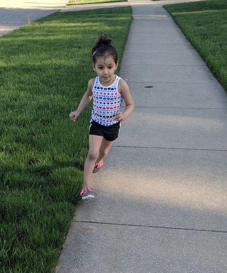 Girl Running On Footpath In Park