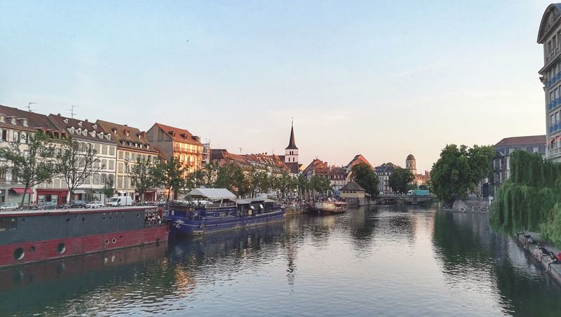 Reflection Water Sunset Town Outdoors City Architecture Strasbourg France Travel Photography Travel Destinations Vacations Cityscape Building Exterior No People Sky Day Nature Politics And Government