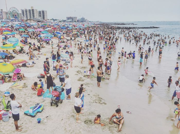 Beach Coney Island / Brooklyn NY 4th Of July Crowd Large Group Of People Beach Real People Group Of People Land Sea High Angle View Leisure Activity Water Lifestyles Men Holiday Day Women Trip Outdoors Nature Sand The Great Outdoors - 2018 EyeEm Awards