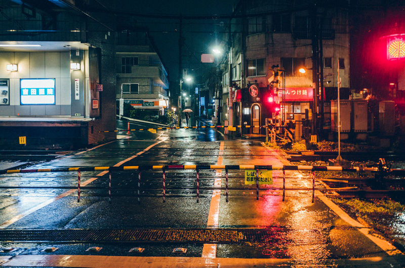Smallpeople Shibuyascapes TOKYO TOKYO Old Meets New Travel Destinations Japan Lovers Japan Night Lights Railroad Track Rain Rainy Days Tokyo Urban Exploration Walking Around Wating Architecture Building Exterior Built Structure City Illuminated Night No People Nostalgia Outdoors Railroad Crossing Road Street Transportation Water Wet HUAWEI Photo Award: After Dark