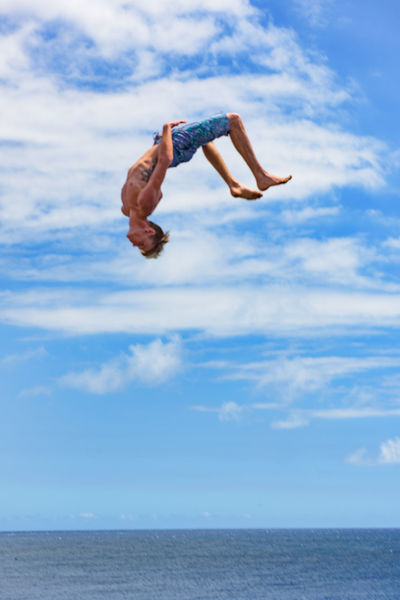A young man jumps at the South Point Cliff. Despite the warning signs against doing so, many kids cliff dive in the ocean below from here. It's a long way down. Adventure Big Island Blue Cliff Diving Enjoyment Flying Freedom Full Length Hawaii Horizon Over Water People And Places Jumping Leisure Activity Lifestyles Majestic Mid-air Non-urban Scene Ocean Sea Sky South Point Cliff Summer Teenager Vacations Finding New Frontiers The Great Outdoors - 2017 EyeEm Awards Sommergefühle
