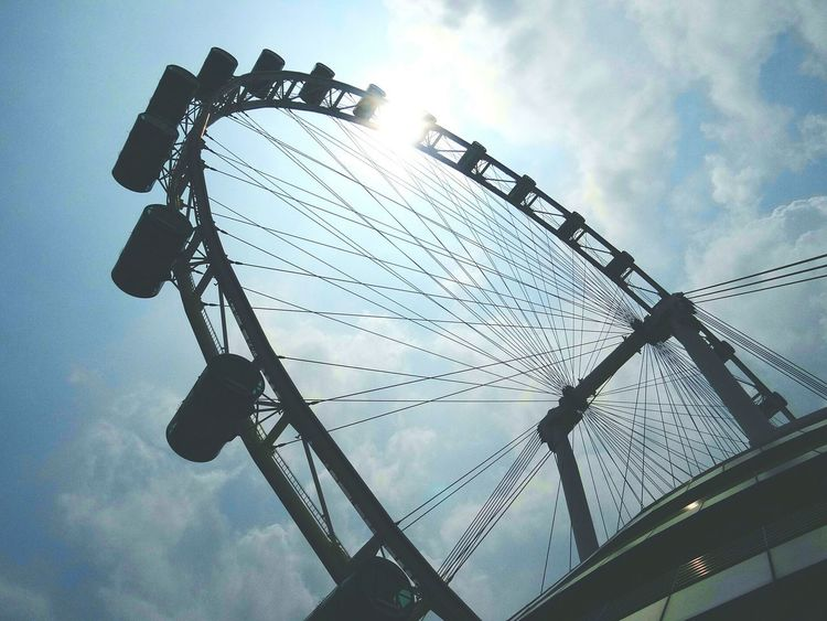 Sky Cloud - Sky Low Angle View Outdoors Day Ferris Wheel Silhouette No People Singapore Flyer Manmadestructures Sunny Day