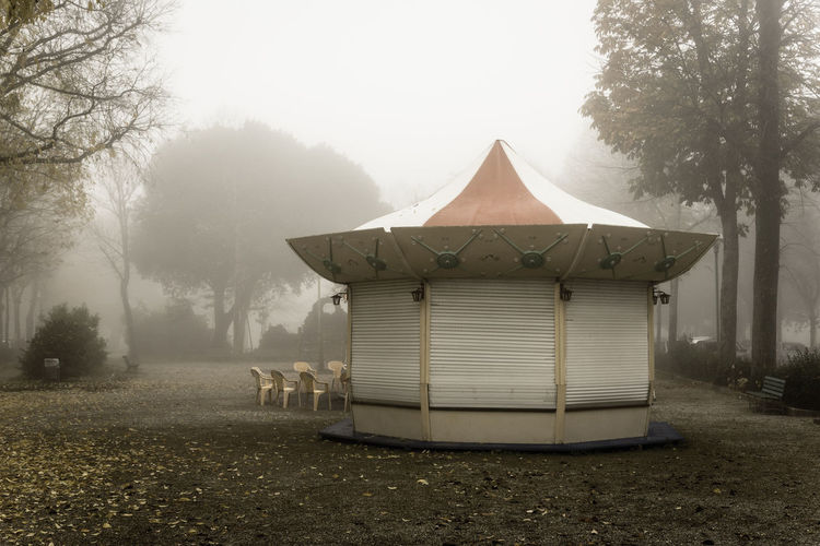 Close carousel shrouded in the fog Abandoned Architecture Beauty In Nature Carousel Day Fog Foggy Landscape Misty Nature No People Nostalgia November Outdoors Retro Sky Tree Trees Vintage Winter