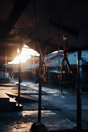 Close-up of tied ropes hanging on roof