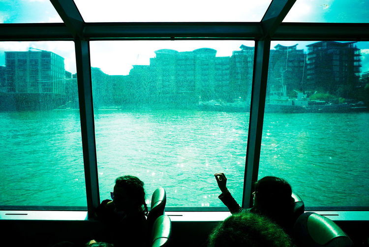 City Street Everyday Lives Ferry Ferryboat Geometric Shapes Postcode Postcards Tourist Traveling Trip View From The Window... Everybodystreet Hand Photographing Playing Real People Streetphotography Togetherness Water Waterway Window Windows