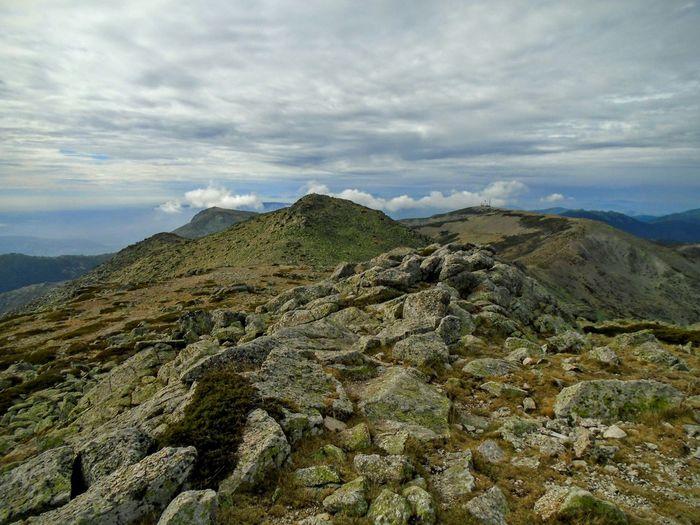 Rocky mountains at sierra de guadarrama against cloudy sky