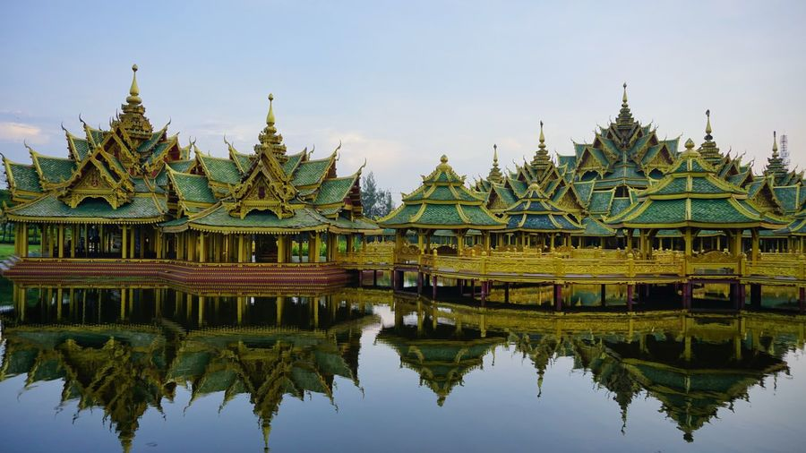 Reflection of temple in lake against sky