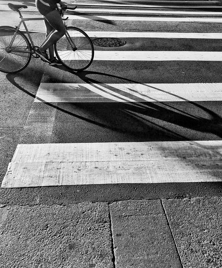Low Section On Person Standing With Bicycle On Street