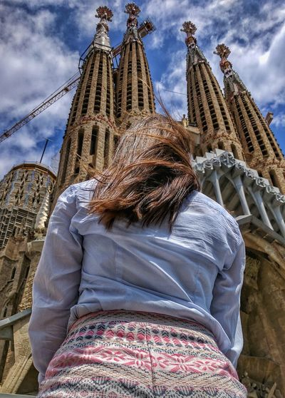 Religion Sky Low Angle View Architecture Cloud - Sky Spirituality Travel Destinations Place Of Worship Day Outdoors Statue Building Exterior One Person Adult Adults Only One Woman Only People España🇪🇸 Catalonia SPAIN TravelDestinations Barcelona Sagrada Familia Sagradafamiliabarcelona Sagrada Família Basilica