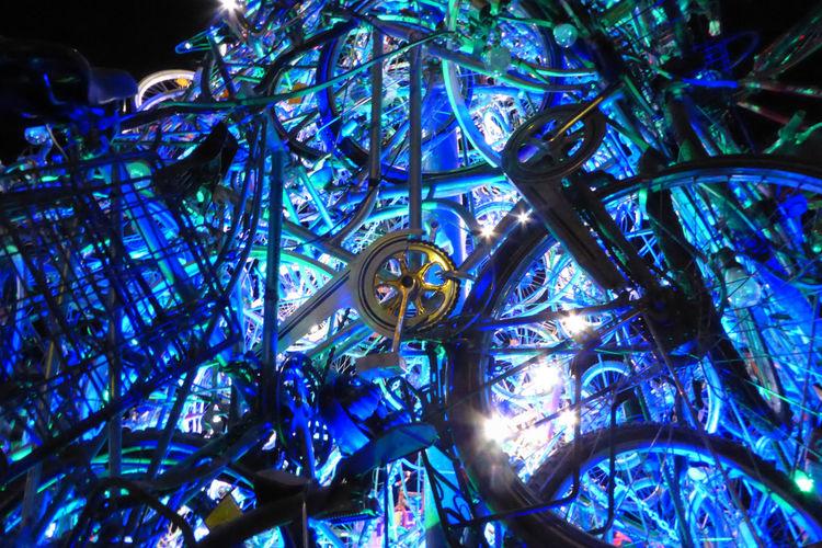 Blue enlighted Installation made of bicycles Illuminated Luminosity No People Night Close-up Bicycles Art Installation Adam Stubley Tollwood Winterfestival Munich München