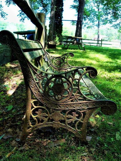 Antique Bench Antique Bench Bench Seat Country Living Indiana Wooden Seat Bench Country Life Countryside Day Empty Grass Green Color Growth Land Metal Metalwork Nature No People Outdoors Plant Seat Tree Tree Trunk Trunk