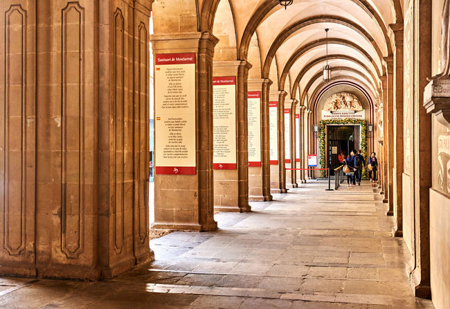 Montserrat, Spain - April 6, 2016: Arcades inside The Benedictine abbey of Santa Maria de Montserrat. Montserrat is a mountain top monastery in Catalonia, situated atop an unusual rock mountain, it is very popular among Catalans, and Catholic pilgrims come from far and wide to see the Black Madonna Abbey Arcades Arches Architectural Column Archways Barcelona, Spain Benedictine Monastery Catalonia Church Columns Editorial  Footpath Historical Landmark Monastery Montserrat Montserrat Monastery Pillars Religion Sanctuary  Santa Maria De Montserrat SPAIN Temple Travel Destinations Walkway