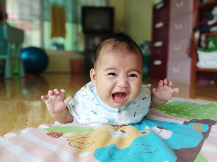 Portrait Smiling Happiness Looking At Camera Cheerful Childhood Cute Baby Headshot Babyhood