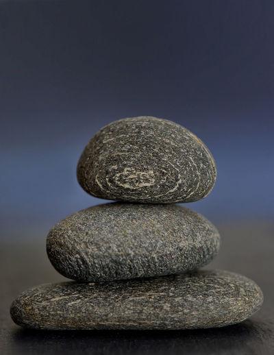 pile of pebble stones isolated in nature Balance Close-up ELLIPSE Gray Background Nature No People Pebble Pebble Stones Spirituality Stone - Object Studio Shot Zen-like