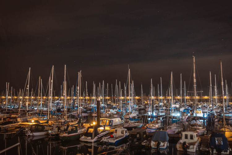 Clear Sky Harbor Illuminated In A Row Mast Moored Nautical Vessel Night No People Outdoors Sailboat Sea Shipyard Sky Water Yacht Colour Your Horizn