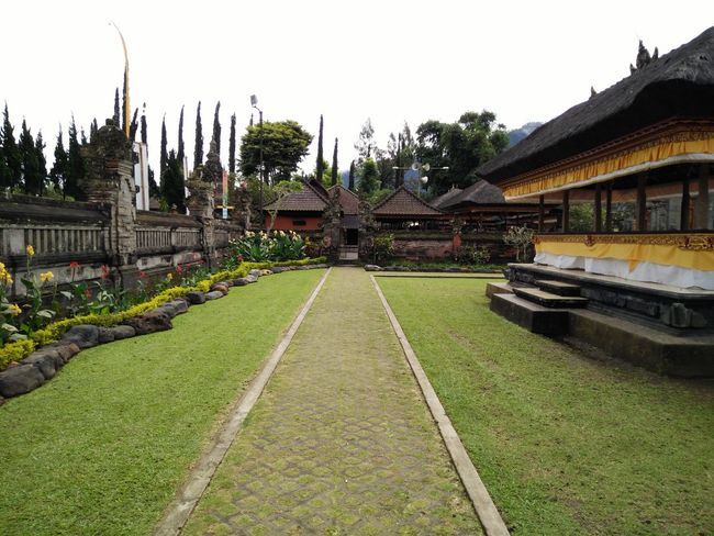 Architecture Building Exterior Built Structure City Day Diminishing Perspective Façade Grass Green Color Growth Lawn No People Outdoors Plant Sky The Way Forward Tourism Travel Destinations Vanishing Point Bedugulbali Bedugul Temple Bali, Indonesia Bedugul