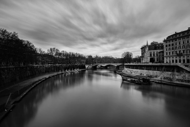 Tiber, the 3rd longest river in Italy. Italy❤️ Italy🇮🇹 Italian Europe Italy Italia Europe Trip Euro River Water Bridge Bridge - Man Made Structure Smooth Blackandwhite Black And White Black & White Sky Tiber Tiber River Rome Roma Smoothreflection Reflection Mirror Road Street Streetphotography Roman Cloud Cloud - Sky