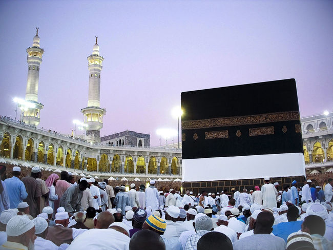 Mecca, Saudi Arabia. - November 6, 2009 ; A beautiful view of Kaaba, just a few meters from it. Adult Architecture Building Exterior Built Structure City Clear Sky Crowd Illuminated Large Group Of People Leisure Activity Lifestyles Men Night Outdoors People Real People Sky Women