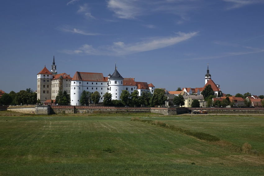 Schloss Hartenfels, Torgau Castle Schloss Hartenfels Skyline Architecture Building Building Exterior Built Structure Cloud - Sky Day Field Grass History Land Nature No People Outdoors Place Of Worship Plant Religion Sky Spirituality The Past Travel Travel Destinations