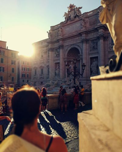 People At Trevi Fountain In City