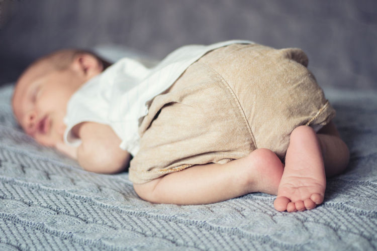 Close-up of boy sleeping at home