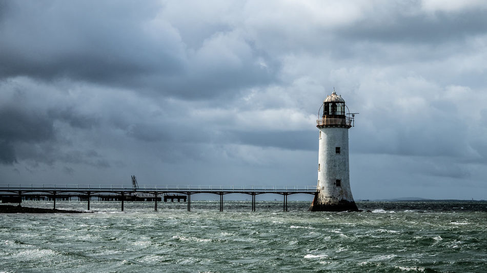 Architecture Building Building Exterior Built Structure Cloud - Sky Day Direction Guidance Lighthouse Nature No People Ominous Outdoors Overcast Power In Nature Protection Safety Sea Security Sky Storm Tower Water
