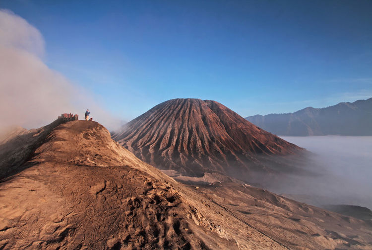 Magnificent View of Mount Bromo, Surabaya, Indonesia with a foggy clouds and amazing sunrise. EyeEm Best Shots EyeEm Nature Lover Active Volcano Adventure Beauty In Nature Day Erupting Geology Landscape Leisure Activity Mountain Nature One Person Outdoors People Physical Geography Power In Nature Real People Scenics Sky Tranquility Travel Destinations Volcanic Crater Volcanic Landscape Volcano