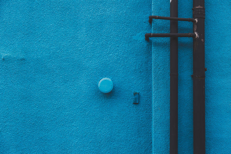 Blue exterior wall of a building Architecture Birmingham Blue Blue Wall Close-up Day Digbeth No People Outside Pipe Sapphire Stone Material Stone Wall Background Teal Turquoise Uk Wall - Building Feature Wall Textures