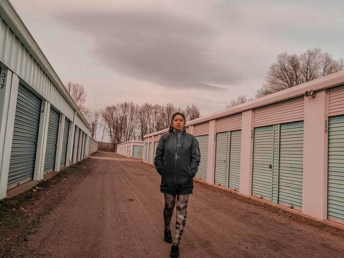 Full length portrait of man standing against sky