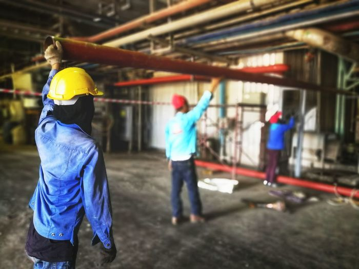 Workers are assembling a water pipe system. Site Construction Site Built Structure Piping Work Men Construction Worker