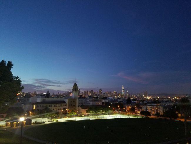 EyeEmNewHere Night Illuminated City Cityscape Sky Outdoors Architecture No People Urban Skyline Blue Building Exterior Tree