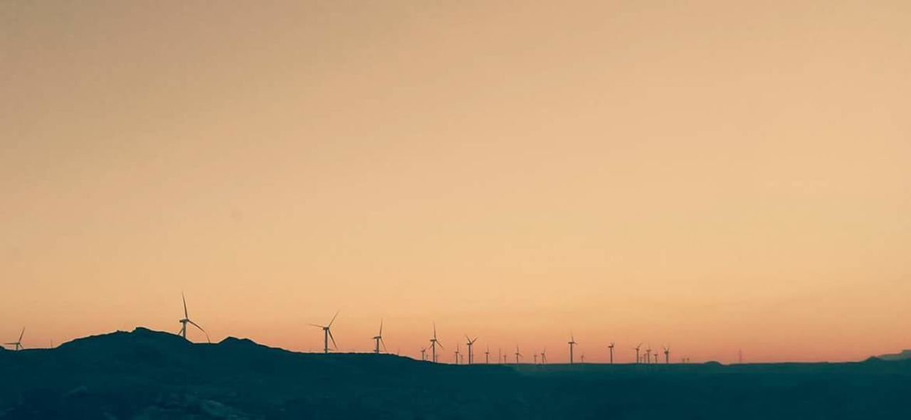 wind turbine, alternative energy, wind power, environmental conservation, fuel and power generation, renewable energy, windmill, sunset, orange color, outdoors, industrial windmill, nature, no people, rural scene, landscape, beauty in nature, scenics, sky, technology, traditional windmill, day