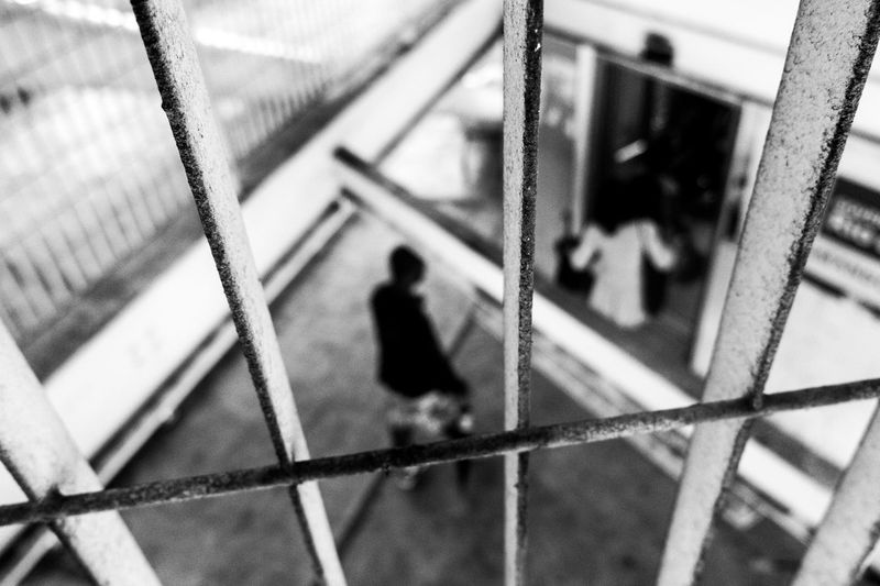 behind the bars Real People Man Woman Insecure Underground City Urban Street Insecurity Inside Indoor Out Of Focus Insanity No Hope EyeEmNewHere
