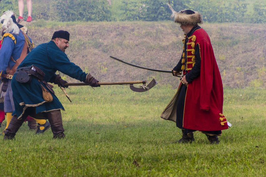 Historical Reconstruction Historical Reenactment Reconstruction Group Soldiers Costumes Fighting Historical Reenactment Outdoors Traditional Clothing Two People Weapon Weapons