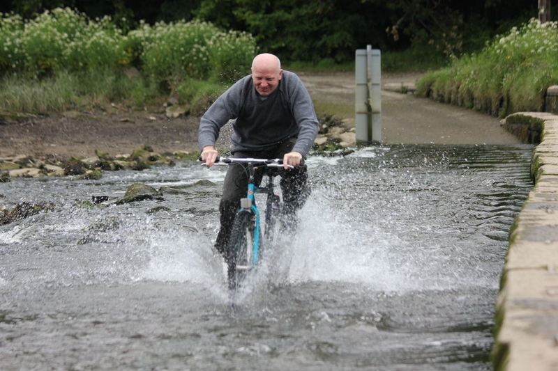 Man Nature Action Shot  Adventure Bike Blue Daylight Front View Full Length Male Motion No Women One Man Only Outdoors Speeding Along Spray Water