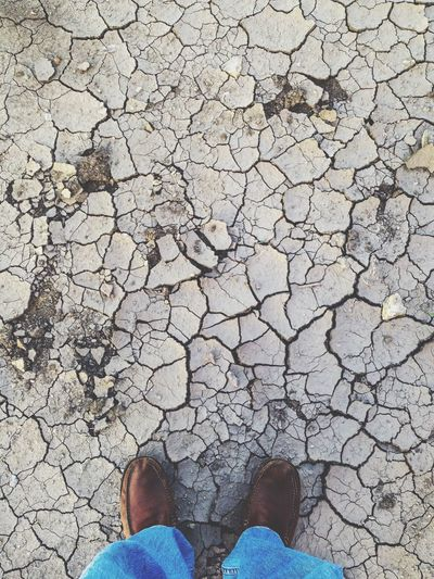 Low Section Cracked Dry Standing One Person Human Leg Real People High Angle View Personal Perspective Lifestyles Environmental Issues Day Arid Climate Outdoors Nature Human Body Part Dried Global Warming