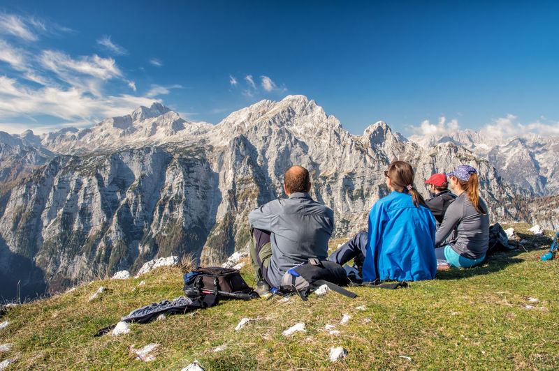 Autumn in Julian Alps in Slovenia, with view of Triglav Mountain Sitting Leisure Activity Rear View Mountain Range Group Of People Adult Women Adventure Men Nature Holiday Togetherness Travel Environment Scenics - Nature People Sky Trip Vacations Mature Adult Outdoors Looking At View Mountain Peak Slovenia