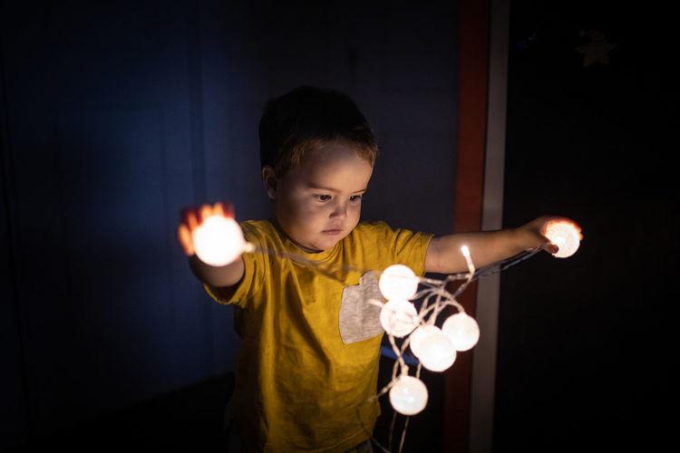 Boy playing in the dark