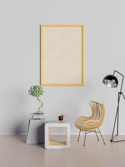 Mock up poster in living room Chair Seat Indoors  Table Absence Furniture No People Wall - Building Feature Empty Picture Frame Lighting Equipment Plant Frame Home Interior Flooring Domestic Room Home Showcase Interior Potted Plant Home Vase Electric Lamp Living Room