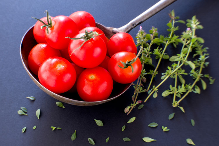 Tomatoes and thyme. Black Background Cooking EyeEmNewHere Fresh Produce Gardening Herb Ingredients Raw Tomatoes Up Close Antioxidant Antioxidant Food Cherry Tomatoes Five A Day Food And Drink Fresh Garden Produce Healthy Eating Mediterranean Diet Red Still Life Thyme Thyme Leaves Thyme Stems Tomato Tomatoes