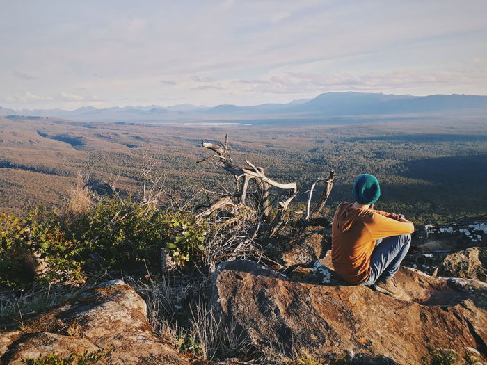 Australia Tranquility Travel Adventure Beauty In Nature Cloud - Sky Environment Grampians Landscape Leisure Activity Lifestyles Looking At View Mountain Mountain Range Nature One Person Outdoors Real People Rock Rock - Object Scenics - Nature Sitting Sky Tranquil Scene A New Beginning
