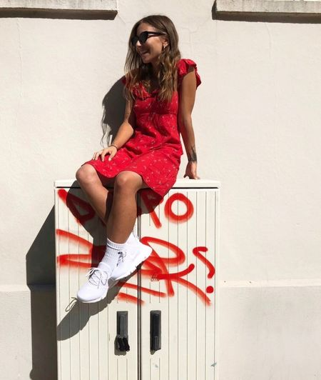 Streetphotography Street Art One Person Fashion Young Women Women Young Adult Full Length Sitting Wall - Building Feature Lifestyles Red Leisure Activity