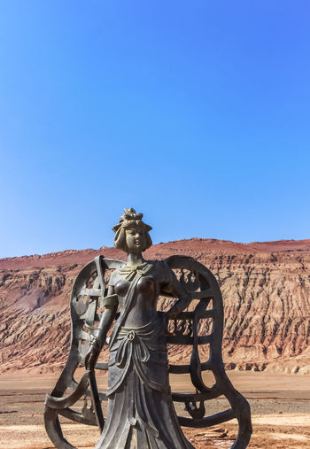 Statue against clear blue sky
