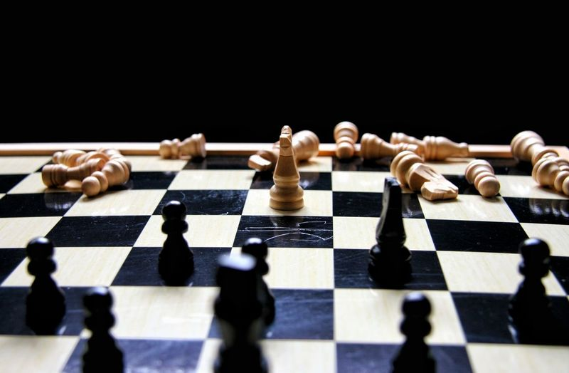 Chess pieces against black background