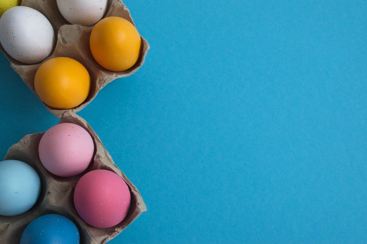 Egg Food Studio Shot Food And Drink Copy Space Indoors  Multi Colored Colored Background Easter Easter Egg Blue Holiday No People Celebration Still Life Group Of Objects High Angle View Blue Background Cardboard Cardboard Box Pastel Pink Color White Color