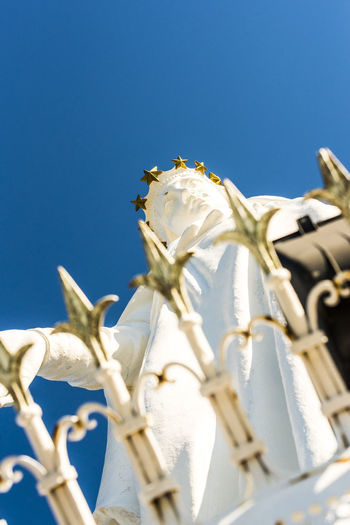 Beauty In Nature Blue Clear Sky Close-up Day Fragility Harissa Lebanon Monument Nature No People Notre Dame Du Liban Our Lady Of Lebanon Religion Religious  Religious Architecture Religious Art Religious Icons Sculpture Selective Focus Shrine White White Color