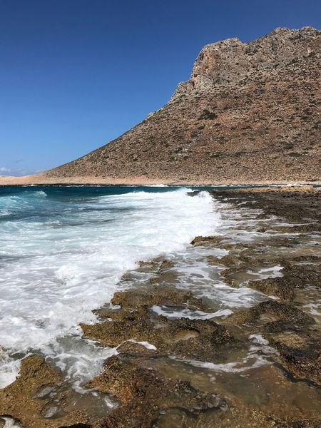 Greece, Crete Stavros Beach Water Sky Sea Beach Beauty In Nature Land Nature No People Wave Rock Tranquility Day Motion