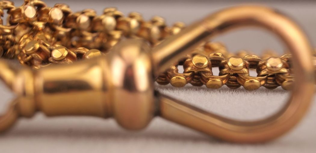 Surface Level Gold Chain On Table