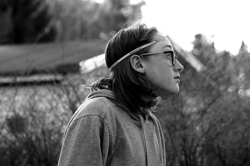 Just posing. Teenager My Son ❤ Glasses 👓 One Person Headshot Outdoors Freckles Boy B&w Photo EyeEmNewHere This Is My Skin The Portraitist - 2018 EyeEm Awards