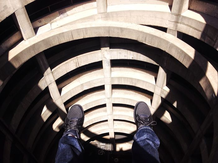 Low Section Of Man Dangling In Front Of Building